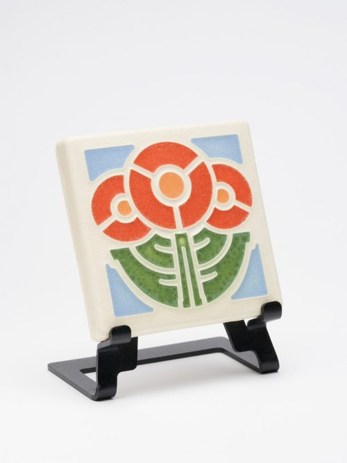 Ceramic art tile with orange flowers by Motawi Tileworks in Ann Arbor, MI.