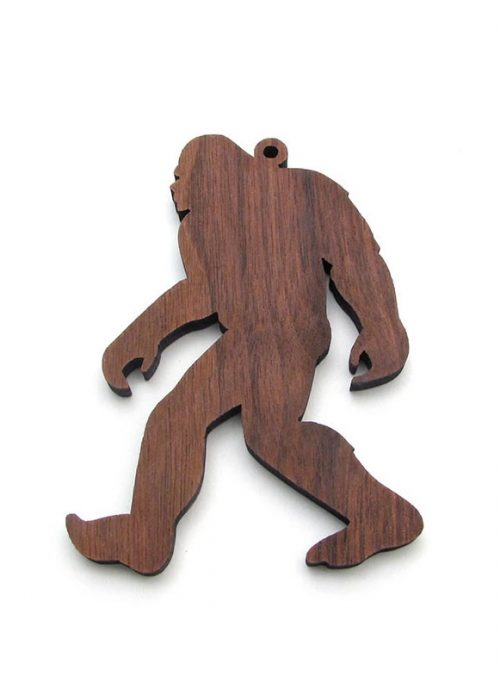 Handcrafted walnut sasquatch ornament by Nestled Pines woodworking.