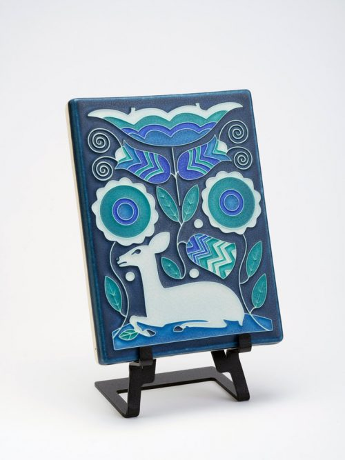 Vienna Woods ceramic art tile in blue by Motawi Tileworks.