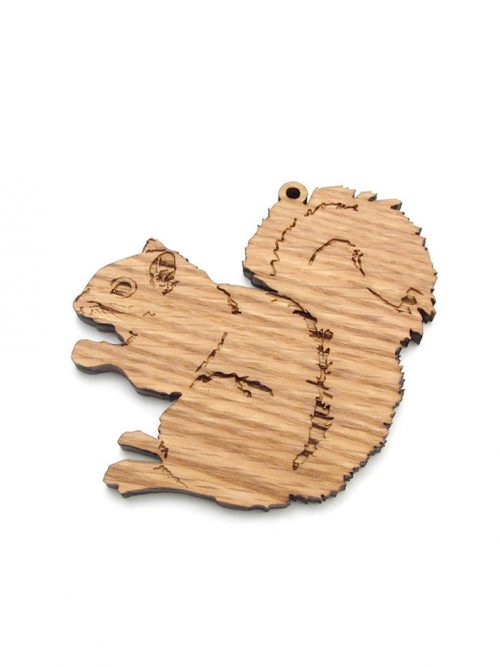 Wooden gray squirrel ornament by Nestled Pines Woodworking.