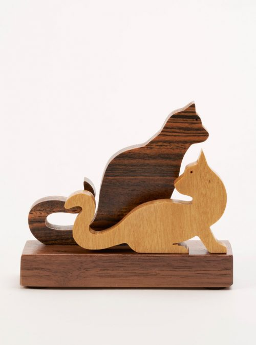 Wooden sculpture of two cats by Jerry Krider.