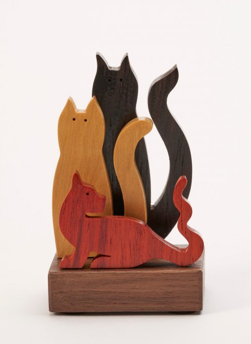 Small wooden sculpture of 3 cats by artist Jerry Krider.