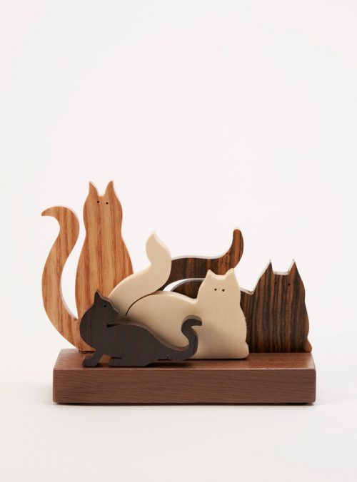 Wooden sculpture of four cats by artist Jerry Krider.