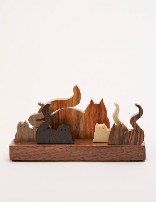 Wooden sculpture of 5 cats by artist Jerry Krider.