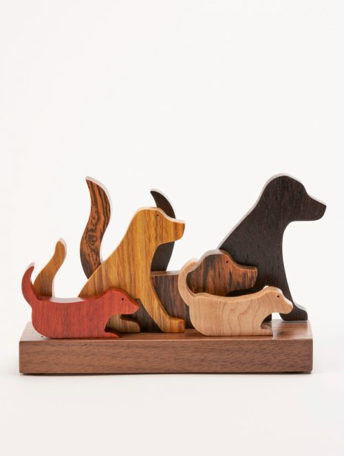 Wooden dog sculpture by artist Jerry Krider.