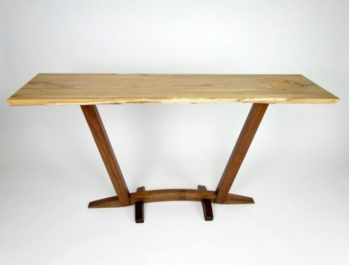 Console table handmade by John Parkinson from a natural edge ash slab with a walnut base.