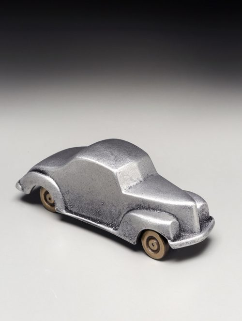 Small metal sculpture of a 1940 ford coupe handcrafted by Scott Nelles.
