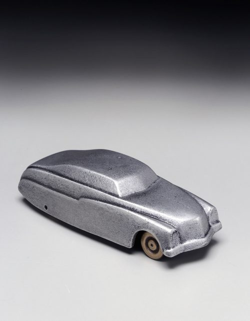 Small metal sculpture of a 1949 Mercury car handcrafted by Scott Nelles.
