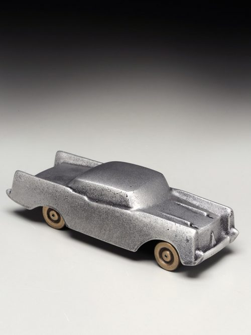 A small, metal sculpture of a 1957 Chevrolet handcrafted by Scott Nelles.