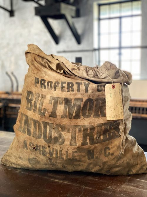 Old sack of weaving bobbins at Biltmore Industries in Asheville, NC.