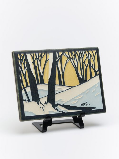 Ceramic tile of a snowscape at dawn by Motawi Tileworks in Ann Arbor, Michigan.