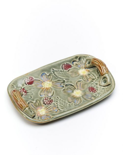Handcrafted ceramic tray with a flower motif by North Carolina potter Vicki Gill.