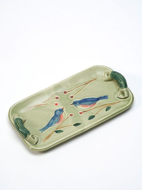 Stoneware tray with a bluebird motif by studio potter Vicki Gill.