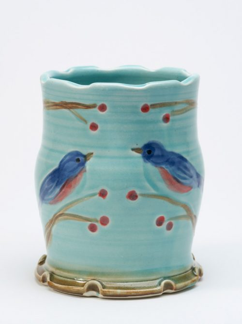 Wheel-thrown, stoneware tumbler with a bluebird motif by North Carolina studio potter Vicki Gill.