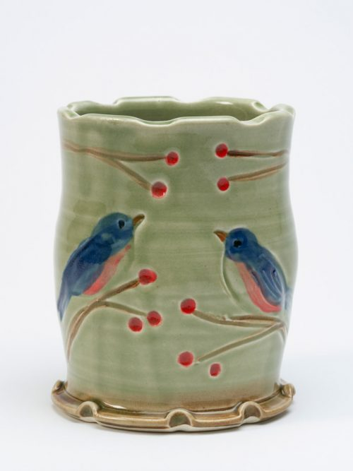 Handcrafted, wheel-thrown tumbler with a bluebird motif by North Carolina studio potter Vicki Gill.