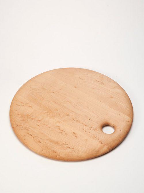 Round birds-eye maple cutting board handcrafted by Edward Wohl.