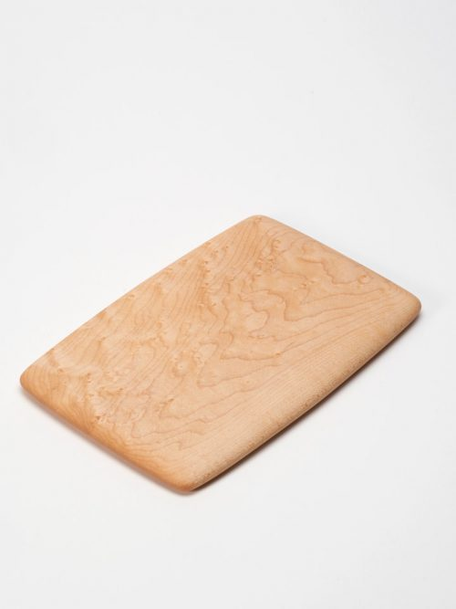 Small birds-eye maple cutting board handcrafted by Edward Wohl.