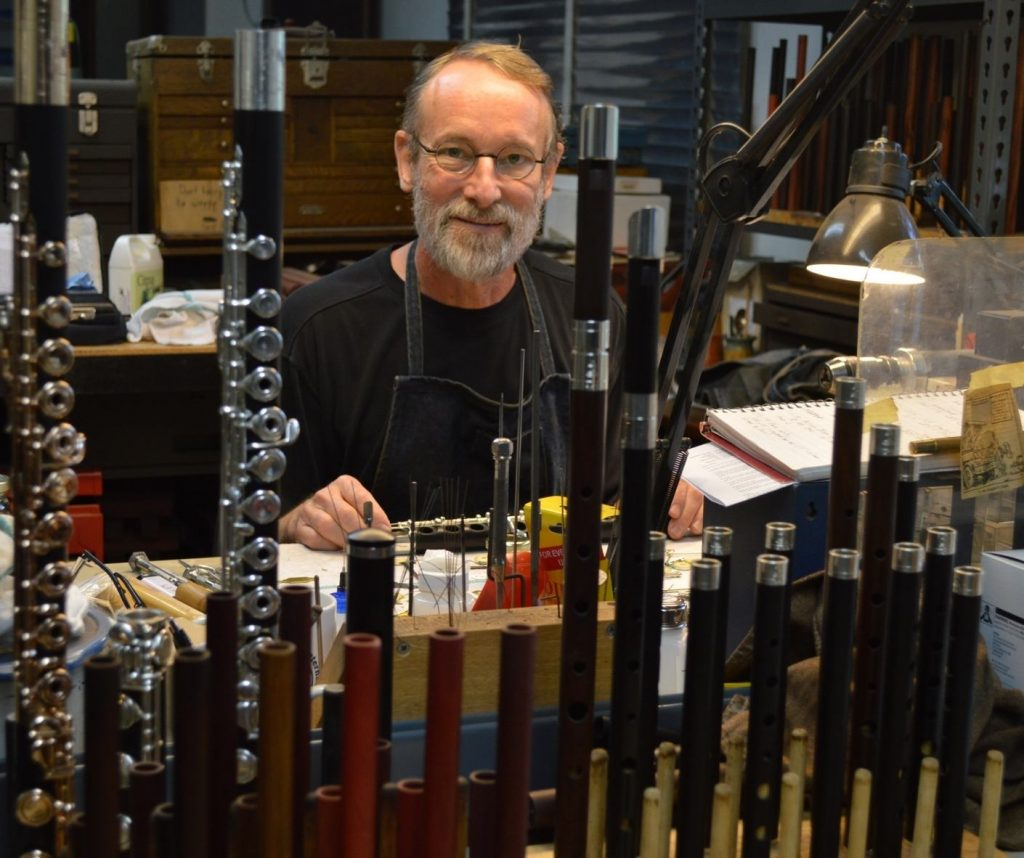Wooden flute maker Crhis Abell in his Grovewood Village studio.