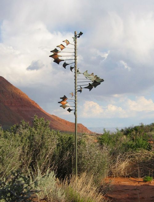 Single Helix Star Wind Sculpture by Lyman Whitaker in an outdoor setting.