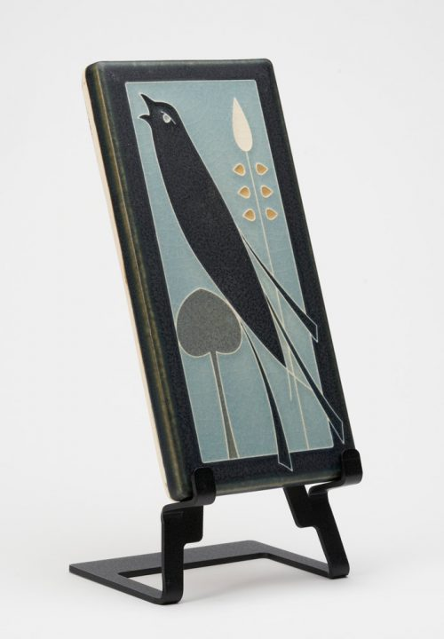 A ceramic art tile with a songbird design by Motawi Tileworks.