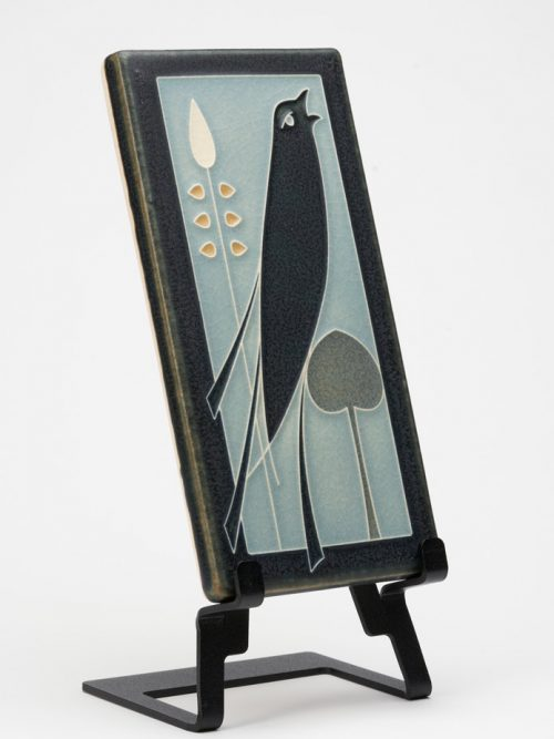 A Motawi Tileworks ceramic tile of a songbird inspired by a book jacket cover by Talwin Morris.