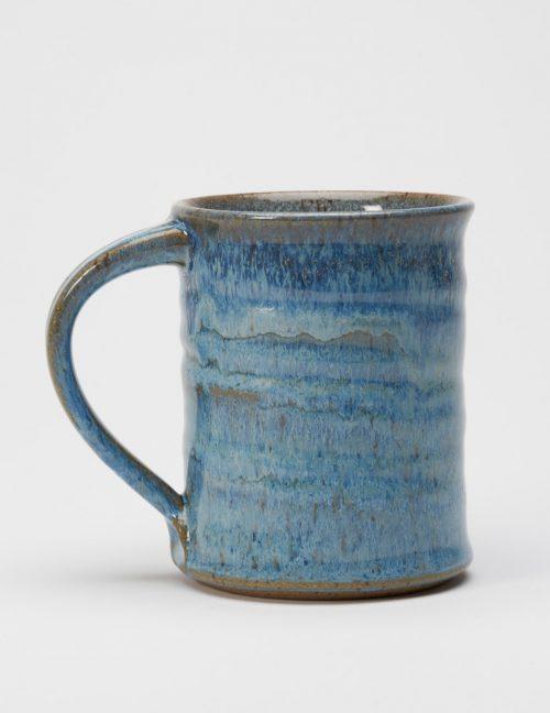 A stoneware mug with a blueberry glaze handmade by potter Steve Tubbs.