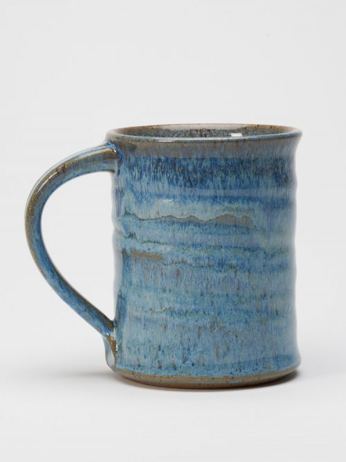 A stoneware mug with a blueberry glaze handmade by potter Steve Tubbs.