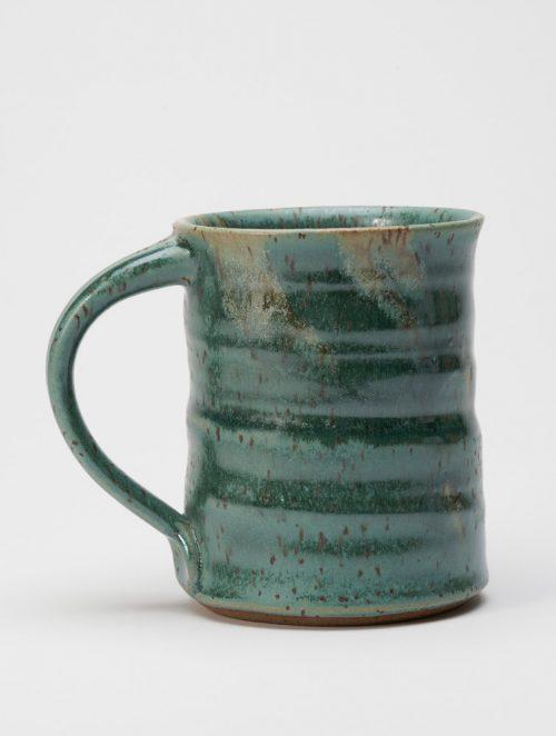 A stoneware mug with a everglade glaze handmade by potter Steve Tubbs.
