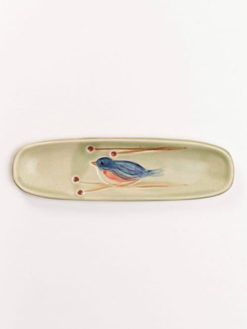 Handmade olive tray with a blue bird motif by North Carolina potter Vicki Gill.