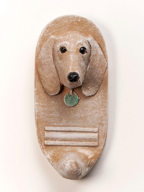 Handmade dachschund leash holder by North Carolina artist John D. Richards of Yummy Mud Puddle.