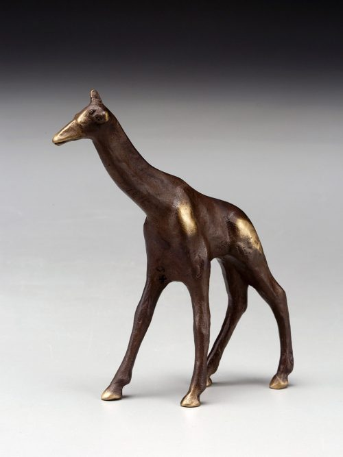 a small, cast bronze giraffe sculpture by artist Scott Nelles.