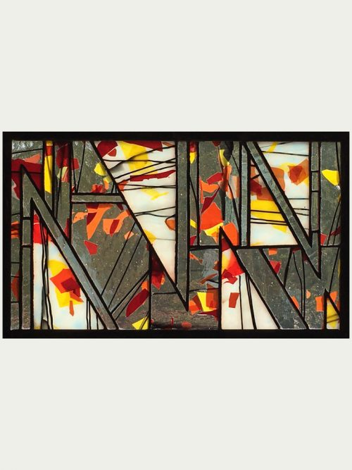 A stained glass window panel by Jacob Hinnenkamp of Hinnenkamp Glass Crafters.