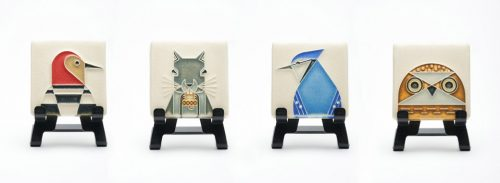 A grouping of four mini ceramic wildlife art tiles by Motawi Tileworks.