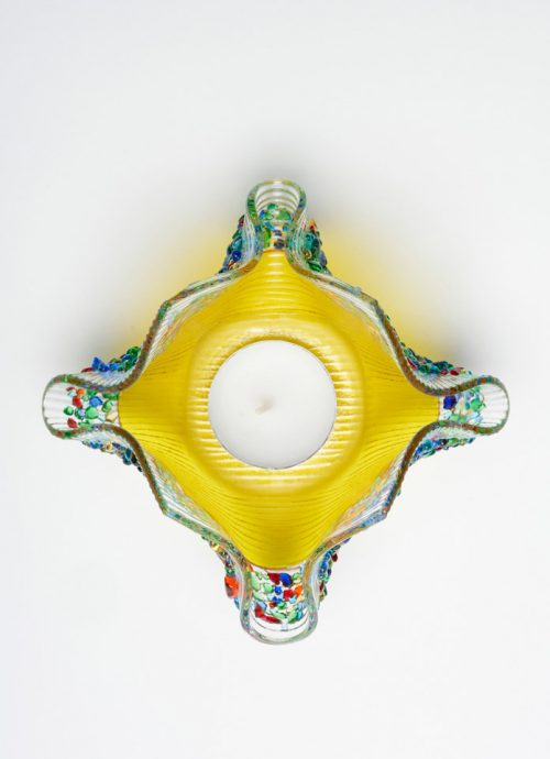 Top view of a yellow confetti glass votive by Jerry and Kathy Galloy.