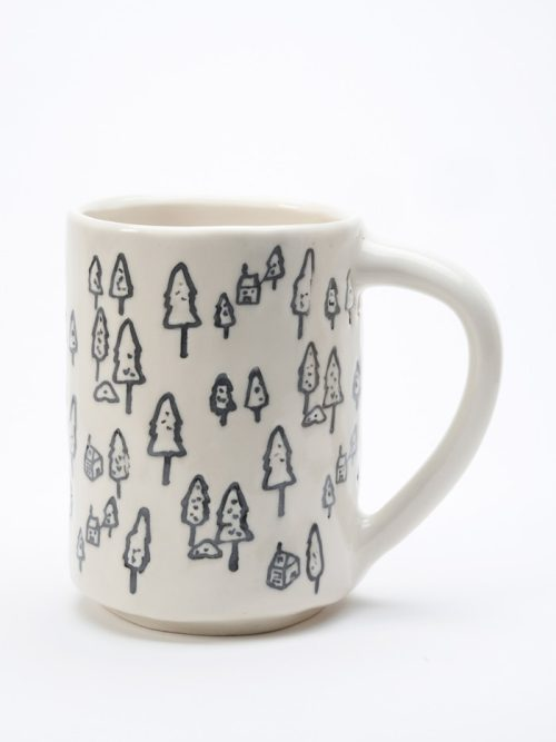Ceramic mug with a forest trees motif by Asheville studio potter Laura Cooke.